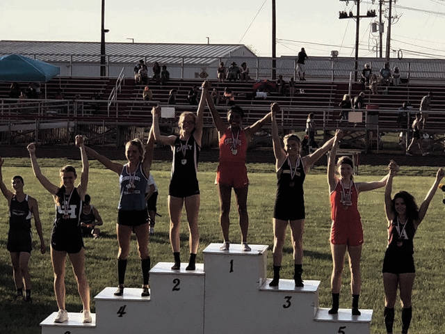 Portsmouth's Lynsey Shipley stands on the top podium after winning the Division III, Region 11 400 meter dash at Fairfield Union High School in Lancaster.
