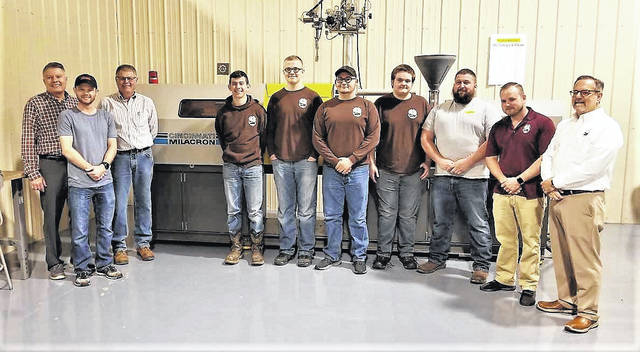 On hand Tuesday to announce Shawnee State University's endowment of automated machinery to Scioto County Career Technical Center were (from left) SSU President Rick Kurtz; Corbin Stockham, a senior Applied Plastics Engineering Technology student; Larry Miller, program director and professor for Applied Plastics Engineering Technology; SCCTC students Ethan Blackburn, Logan Little, Zach Fuller and Kevin Deel; Ryan Kenton of FANUC; Justin Tackett, RAMTEC Center director; and Stan Jennings, SCCTC superintendent.