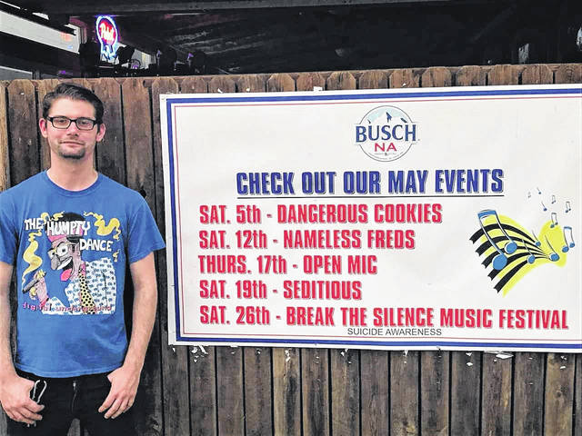 One of four organizers for the Break the Silence fundraiser, Matt Eichenlaub stands alongside the banner at Frank-N-Steins in downtown Portsmouth, announcing the first of several events leading up to a main event in Olive Hill, Ky. Eichenlaub is a sometimes DJ at the Portsmouth tavern.