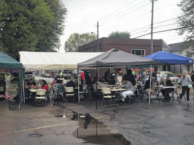 Despite rain, guests still enjoyed Cinco de Mayo outdoor activities such as face painting.