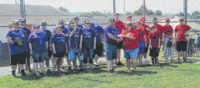 Mike Bell, president of The Autism Project of Southern Ohio, presented a $1,500 check to Michele King, president of District 11 Challenger Baseball League.