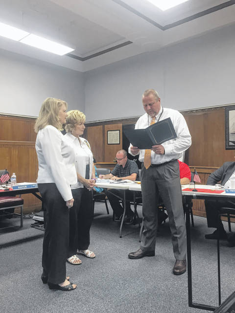 Mayor Kevin E. Johnson presenting the proclamation to the ladies of the DAR.