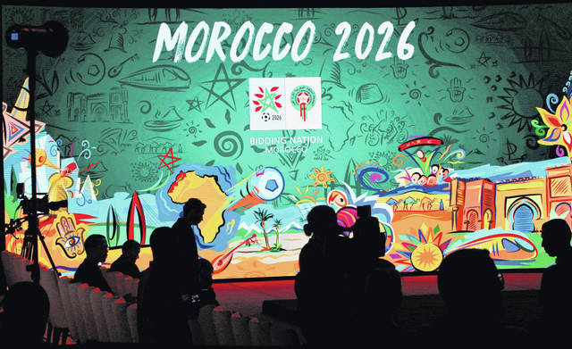 """FILE - In this Saturday March 17, 2018 file photo, a giant screen display the logo of Morocco 2026 inside of the reception before a press conference to promote Morocco's bib for the 2026 soccer World Cup in Casablanca, Morocco. The North American bid to host the 2026 World Cup has outscored Morocco following inspections with FIFA labeling the North African proposal """"high risk"""" in three areas, it was announced on Friday, June 1. The joint bid from the United States, Canada and Mexico scored four out of five while Morocco scored 2.7 following FIFA inspections. (AP Photo/Abdeljalil Bounhar, file)"""