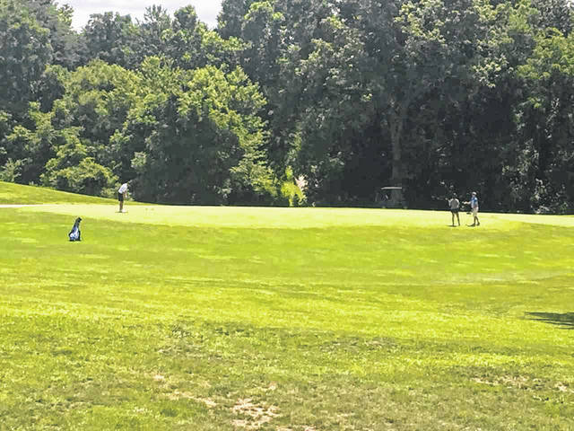 Golfers enjoy a beautiful afternoon Thursday at Shawnee Golf Course