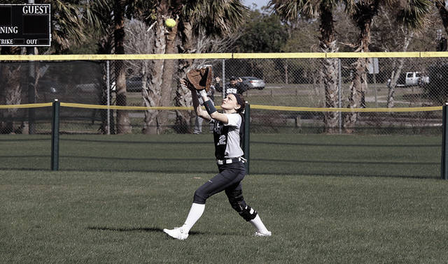 Shawnee State University's Morgan Rearick makes a grab in the outfield. Rearick, who hit .265 as a freshman, will join SSU's volleyball program in the fall.