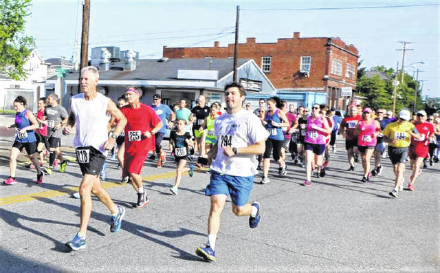 Ron Simpson (runner 218 at left) of Russell, Ky., is one of only a handful of active runners who ran in the first Run By The River 41 years ago. He is registered for this year's race.