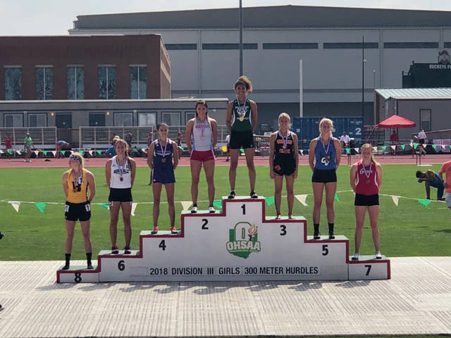 Wheelersburg's Ellie Ruby (middle right) stands third on the podium in the 300 meter hurdles.