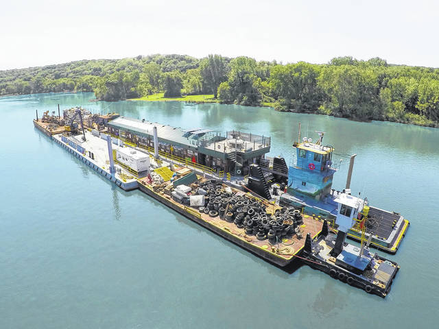 Living Lands and Waters' garbage barge makes its way down an unidentified waterway.