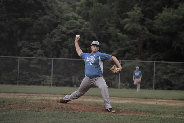 Ethan Lauder works in relief on Thursday evening.