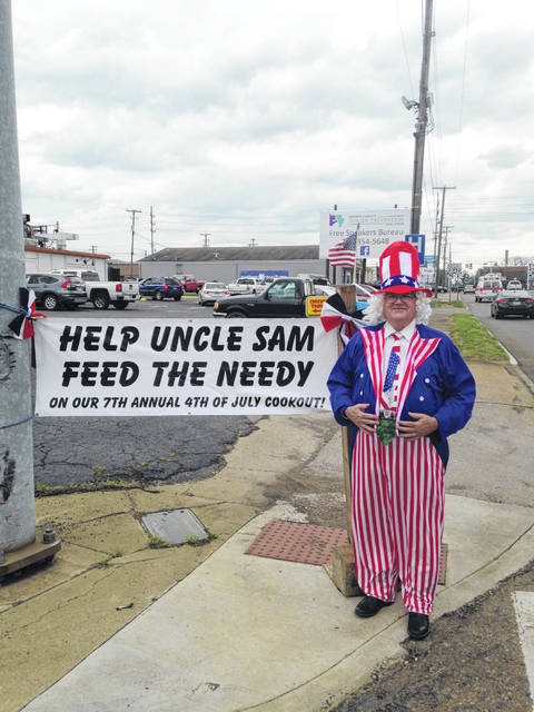 Pastor Gary Newman on the street corner collecting money for his special 4th of July Cookout