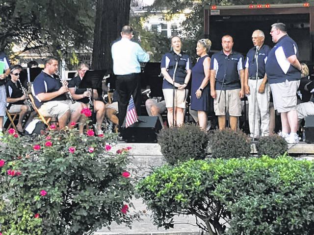 The Portsmouth Wind Symphony launched their 25th anniversary July 4 concert in Tracy Park with the national anthem sung by some volunteer voices. About 60 to 70 folks braved temperatures nearing 100 degrees to enjoy the show. The homegrown orchestra was wrapping up their 25th year of playing.