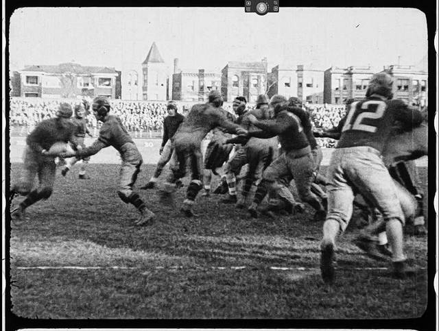 A screenshot of the Warner Brothers produced game film of the Portsmouth Spartans taking on the Chicago Bears at Wrigley Field.