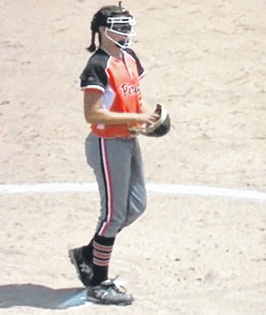 Ashley Spence prepares to deliver a pitch in her four inning perfect game