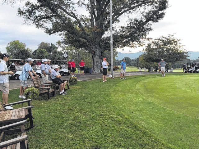 Players from last year's scramble wait to tee off