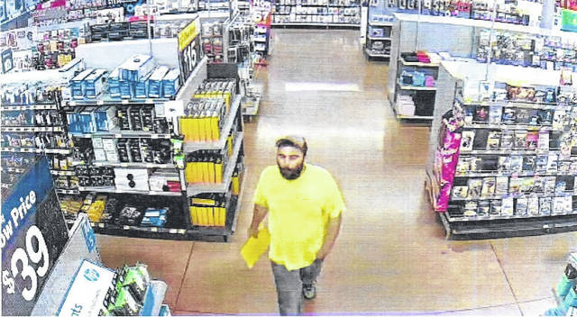 Security camera photo of the suspect in Sunday's robbery at the Walmart in New Boston.