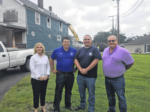 (left to right) Michelle Throckmorton with the Scioto County Land Reutilization Corporation, Scioto County Commissioner Bryan Davis, Andy Gedeon from the Portsmouth City Health Department, and City Manager Sam Sutherland.