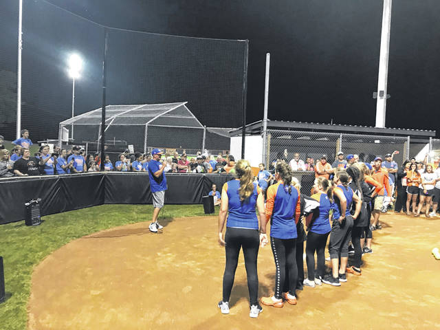 Head coach Dusty Salyers addresses the hundreds of people who came to Gene Bennett Park late Thursday night.