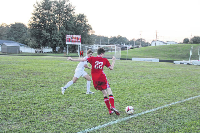 Freshman Zane Miller attempts to beat a Northwest defender in the Falcons victory Tuesday night, 3-1.