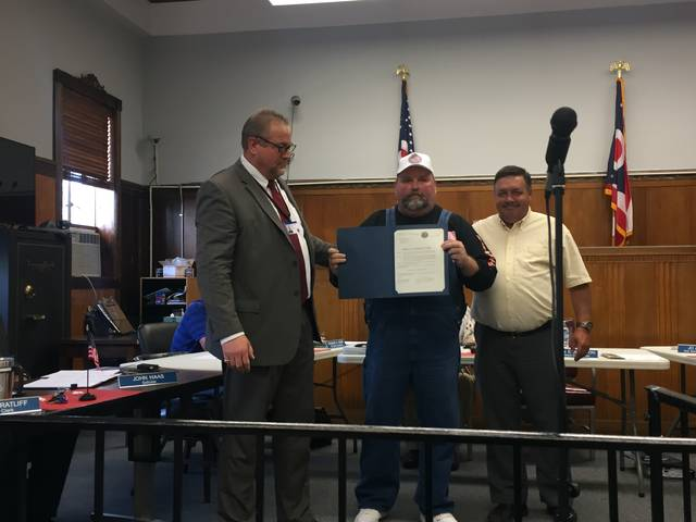 """Kevin E. Johnson presents True Lure """"No Kill"""" Deer Hunt Proclamation to Todd Dunn and Mike Bell."""