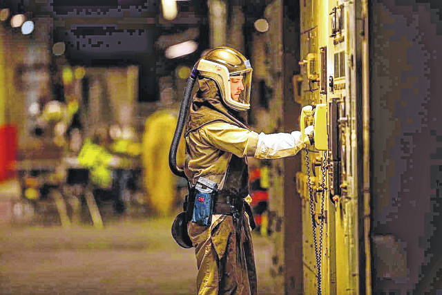 Earlier this year, Fluor-BWXT and DOE invited the Daily Times on a tour of the Portsmouth A-plant and the ongoing construction of the landfill. They would not allow photography of the site, but Fluor provided photos such as this one of a deconstruction worker in full haz-mat gear.