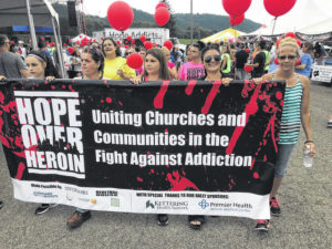 Hope over Heroin event draws large crowd to outskirts of Spartan Stadium Friday night