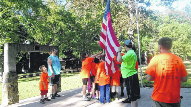 The kids at the 2nd annual Austism Camp raise the American flag to start the weekend.