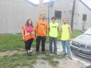 Employees save man from burning car