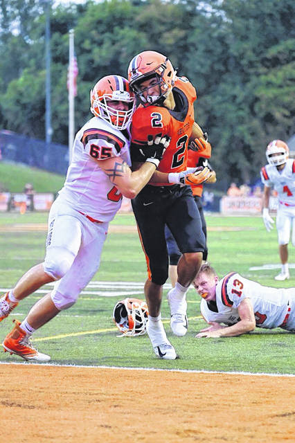 Senior wide receiver Tanner Holden finds the endzone for his first touchdown of the season in Wheelersburg&#8217;s victory over Heath, 48-0.<strong></strong>