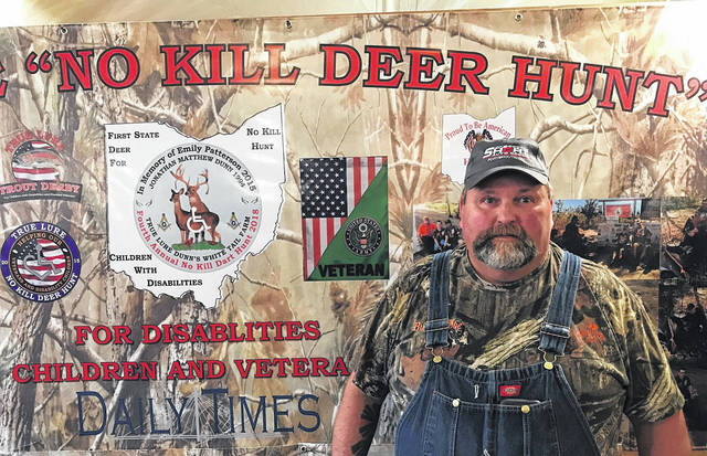 No kill deer hunt founder Todd Dunn in front of part of the display set up Saturday at Rareden's White Tail Deer Festival.
