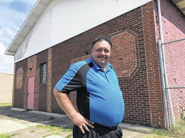 Autism Project of Southern Ohio President Mike Bell stands outside the Waller Street building the autism group should by now be calling home.